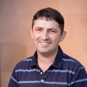 Headshot of man smiling at the camera.