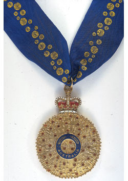 The gold medal and blue ribbon given to Companions of the Order of Australia.