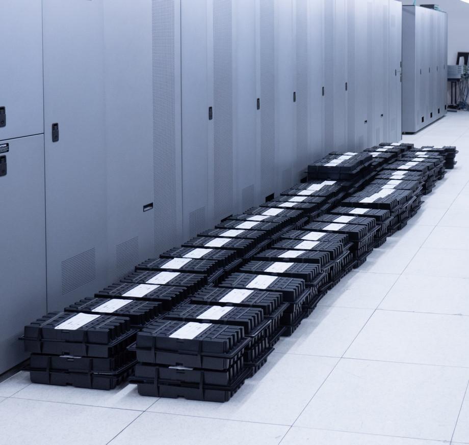Hard drives stacked along a wall.