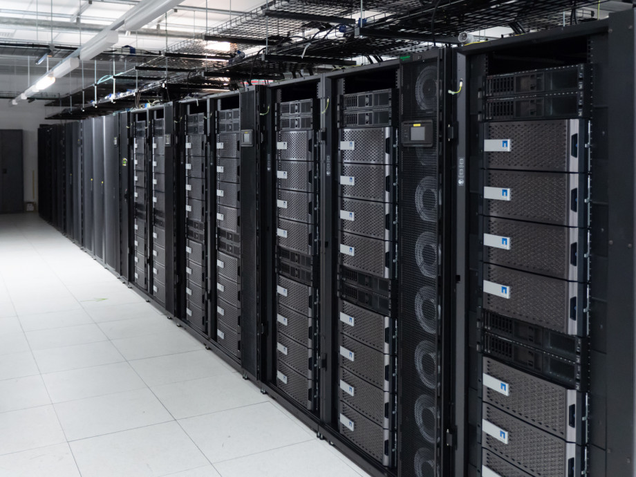 A row of computer equipment in a data centre.