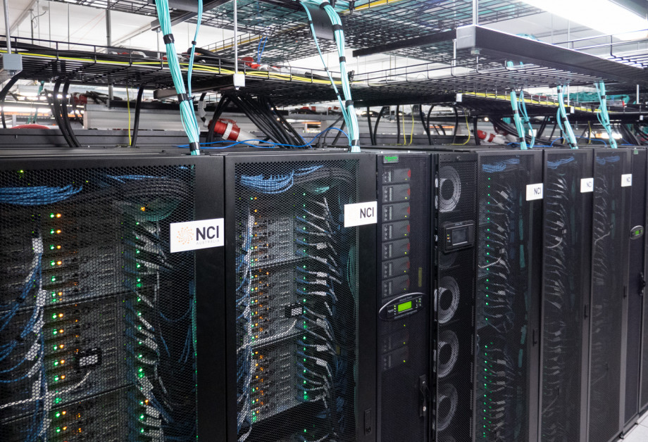 An overhead view of some of the Gadi supercomputer racks.