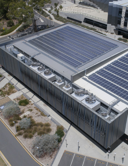 Overhead view of the NCI building showing the entire roof covered in solar panels.