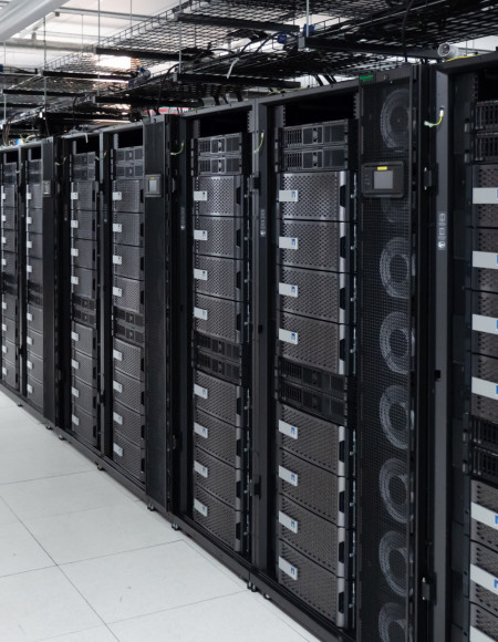 A long row of storage arrays with grey front faces stacked together.