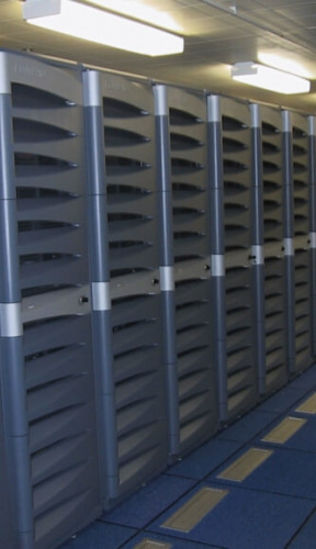 A bank of computer racks covered in grey plastic.