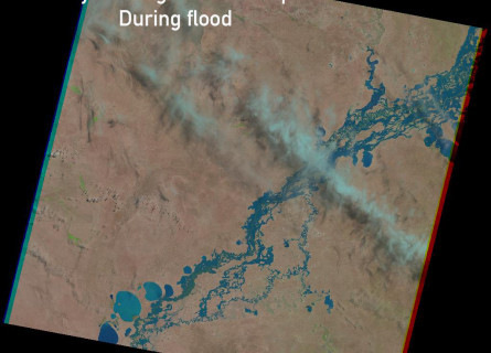 Satellite image showing the bright blue river with flooded area around it in the middle of a brown landscape. The words Murray-Darling Basin Floodplain During flood are superimposed over the image.