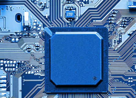 A blue image centred on a motherboard with a big computer chip.