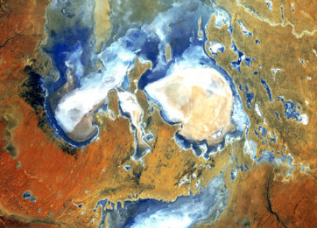 Lake Eyre Kathi-Thanda viewed from space, several blue and white lakes surrounded by red desert.