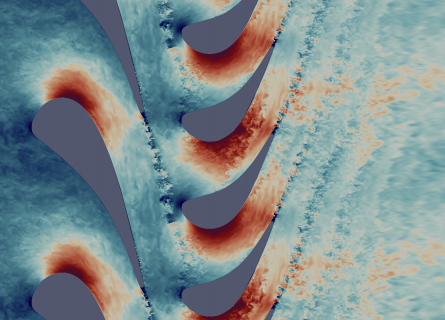 A view of turbulent air flows inside a gas turbine using Direct Numerical Simulation. Air in shades of blue (for slow) and red (for fast) swirl off from the tip of turbine blades.
