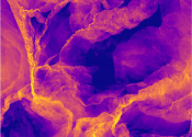 Abstract image showing yellow strands and hazy shapes on a purple background.