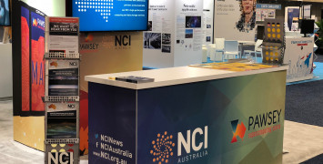 The front counter of the NCI and Pawsey booth at the SC18 conference.