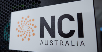 NCI logo on a black cabinet, with some flashing lights showing through behind it.
